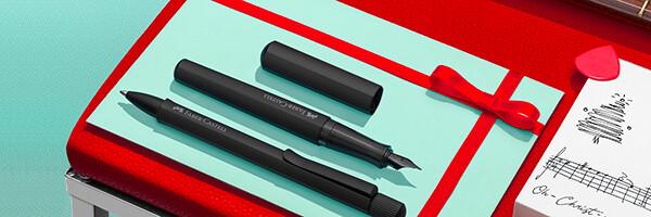 černé plnicí pero a propiska Faber-Castell Hexo
